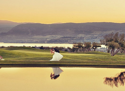 Bride and groom across the lake at the Harvest Golf Club in Kelowna @ their wedding.
