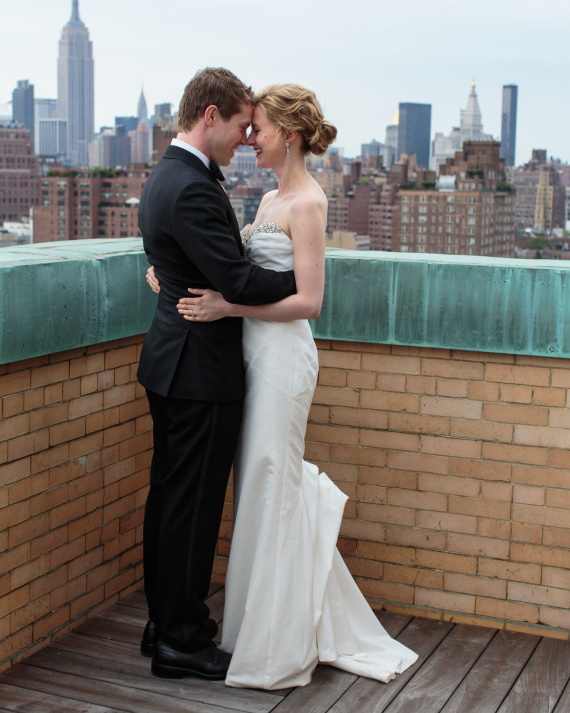 6 Bride and groom rooftop photoshoot overlooking city photo