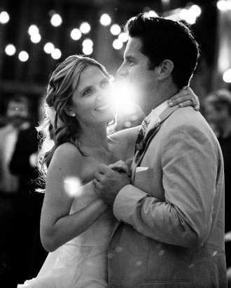 8 wedding couple first dance picture backlit with lens flare black and white