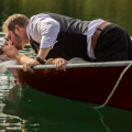 Kamloops Wedding Venue Blog Post - List of the different wedding venues in Kamloops. This photo is of the bride and groom in a rowboat at Johnson lake resort nearby Kamloops
